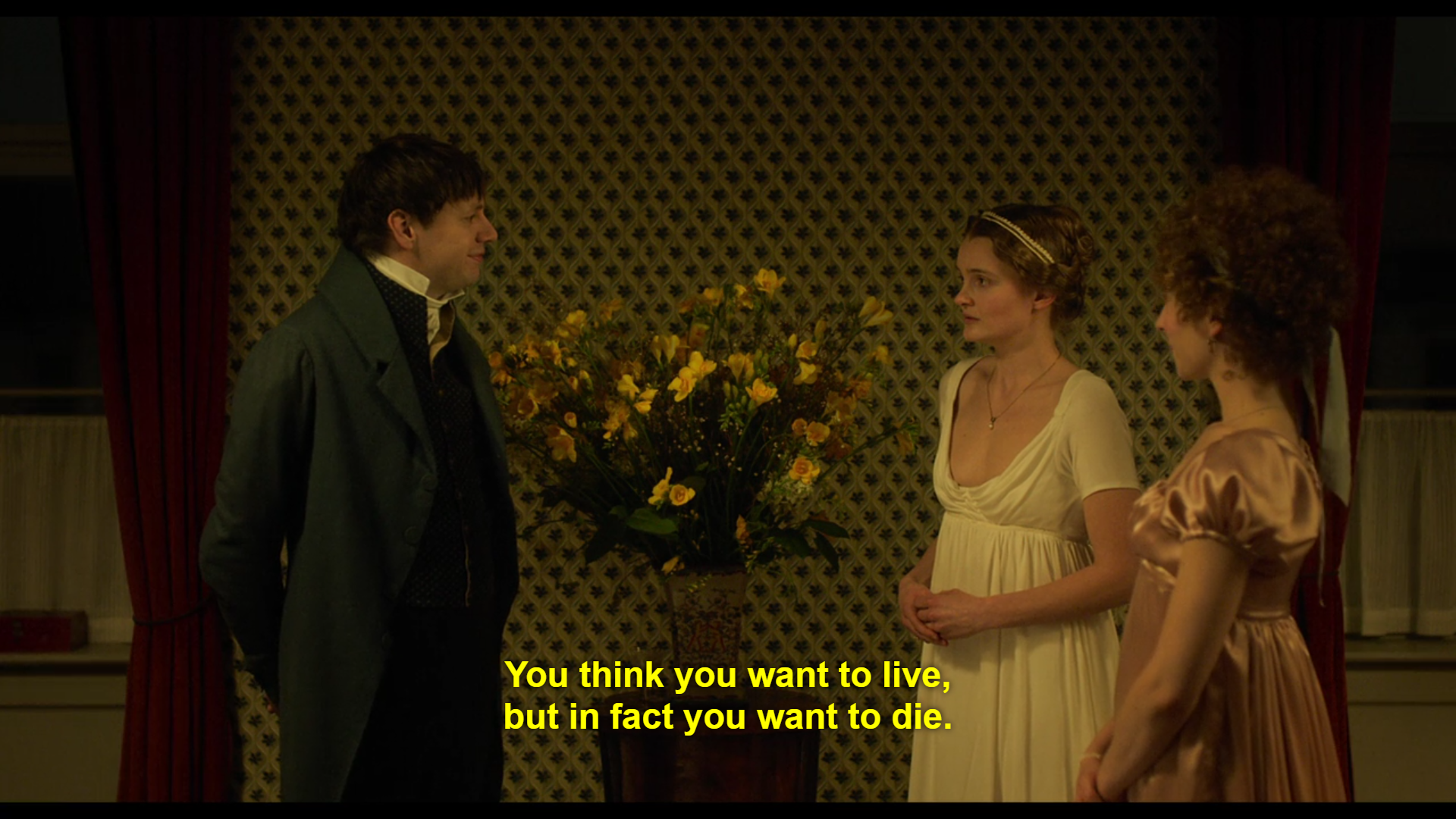 """a man faces two women in period costume and speaks the words """"You think you want to live, but in fact you want to die"""""""