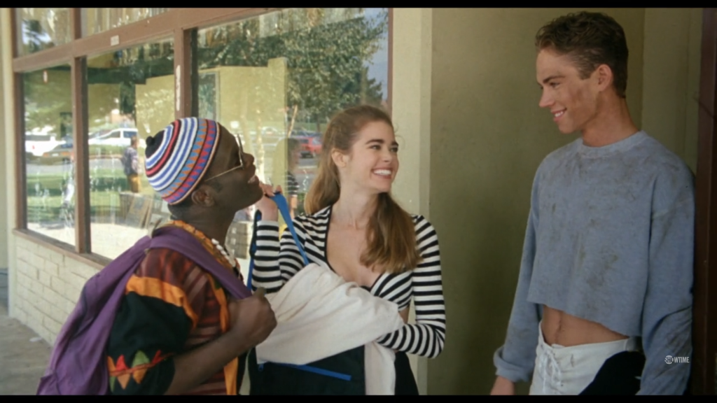 Tammy, a teen with dark blonde hair, smiles as she introduces her boyfriend Michael, a tall white boy muddied from football practice, to her friend Byron, a black teen wearing colorful African-inspired garb.